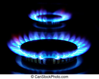flames of gas stove in the dark