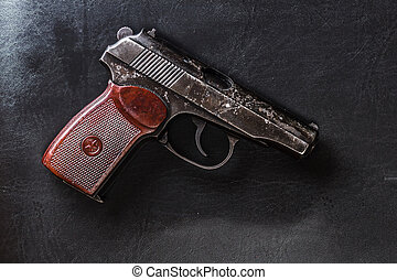 semi-automatic pistol on black leather - Weathered generic...