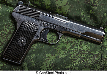 semi-automatic pistol on pixel camouflage background -...