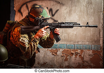 Soldier with the russian machine gun in abandoned building,...