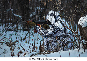 Soldier with the russian machine gun in snow outdoors, hero...