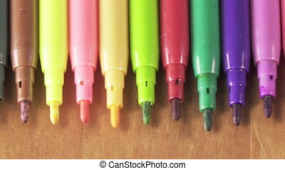 felt-tip pens of various color lie in a row ,