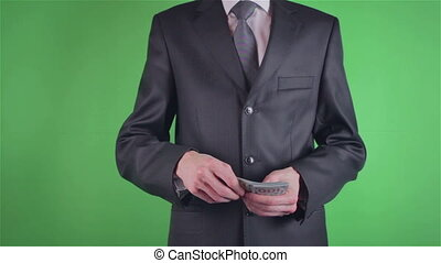 Handsome young man throwing money on chroma key or Green...