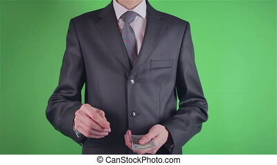 Handsome young man count money on chroma key or Green screen
