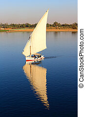 Fellucca on the Nile River Egypt - Felluca with white sails,...