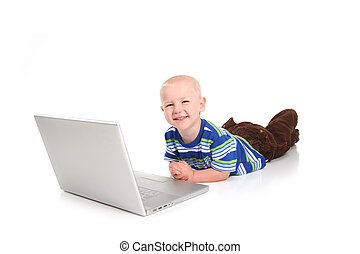Little Boy Learning to Use a Laptop Computer