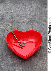vintage key and red heart on grunge wooden backgroundu3000