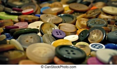 Lots Of Mixed Buttons Rotating - Closeup of buttons in many...