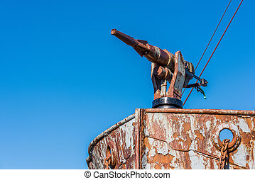 Close-up of harpoon gun on rusty bow