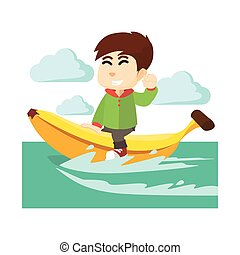 Boy ridding banana boat