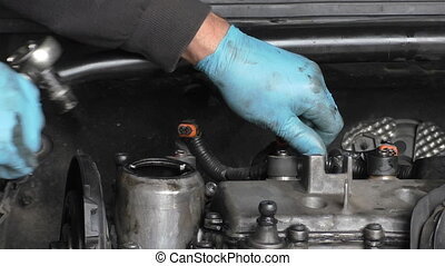 Car mechanic working under hood - Car mechanic working under...