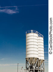 metal silos against blue sky