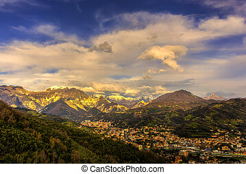 Carrara at sunset - Panoramic view of city of Carrara before...