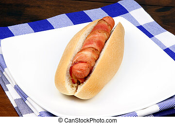 hot dog with bacon - hot dog rapped in bacon o withe plate...