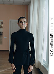 Portrait of a young boy who is engaged in dancing - Man...