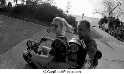 United Family Travelling on the Bike - Monochrome shot of...