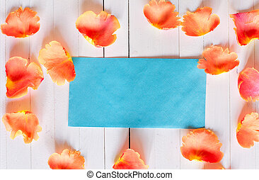 envelope with a place for signatures among rose petals