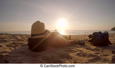 Man with Hat on Face Getting Suntan - Man with hat on the...