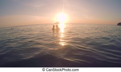 Father and Child Playing in Sea