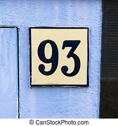 Number 93 - House number ninety three on a ceramic tile