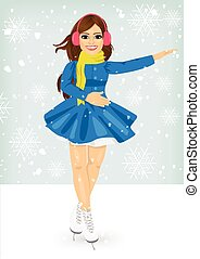 attractive woman in winter coat skating outdoors on the ice rink