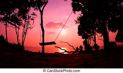Silhouette of the Swings at Sunset - Silhouette of empty...