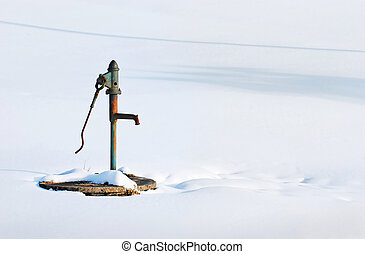 Water well - The old well on the snowy field
