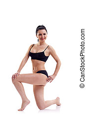 sporty girl - Photo of sporty girl doing stretching exercise...