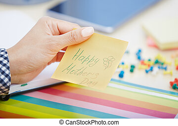 Happy mother day - Human hand holding adhesive note with...
