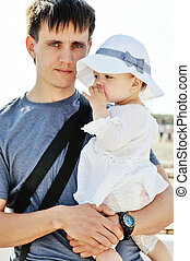 father holding baby girl daughter - young father holding...