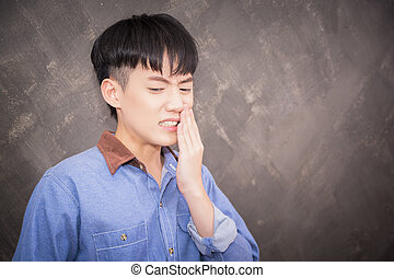 youngman toothache or sad in home