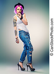 body tattoo - Full length portrait of a modern young girl...