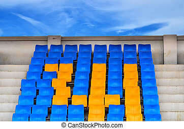 Grandstand Chairs on blue sky background