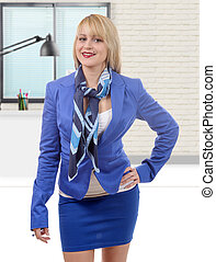beautiful young and blond businesswoman with blue suit - a...