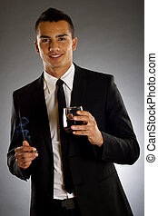 smoking and drinking - picture of a young businessman...