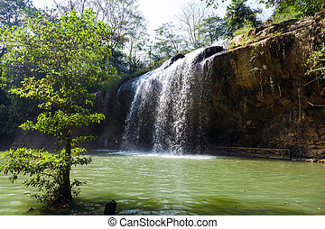 Blue stream waterfall in Vietnam in sunny weather