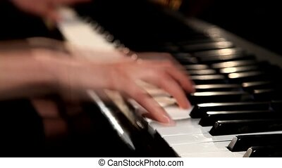 Woman Pianist Hands plays The Grand Piano