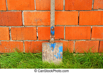 Work tool - Spade on the red brick wall background