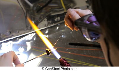 Production of hand made beads, sixteenth video - Production...