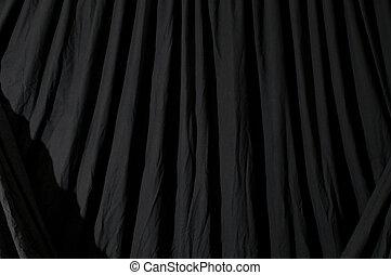Draped black backdrop cloth