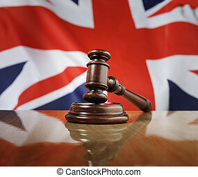 United Kingdom Law - Mahogany wooden gavel on glossy wooden...