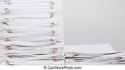Stack overload paper on white table time lapse - Stack...