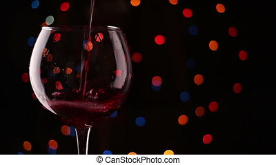 pouring wine into glasses. Flashing background.