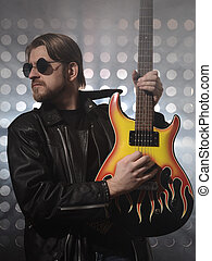 Attractive bearded man plays guitar in smoke - Attractive...