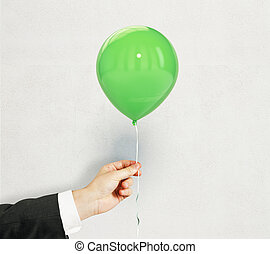 Hand with green balloon