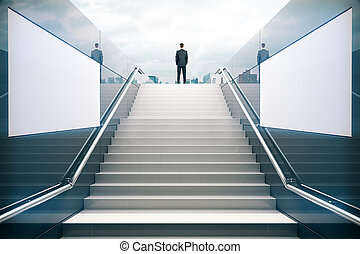Businessman on white stairs - White stairs in pedestrian...