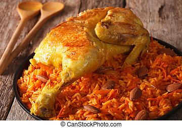 Traditional Arabic food: kabsa with chicken closeup. Horizontal
