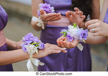 Close up of bridesmaids hands with bouquet - bridesmaid in...