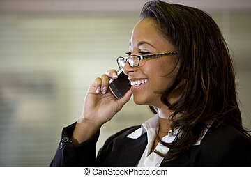 Young African-American woman talking on mobile phone - Young...