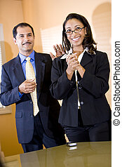 African American office worker getting pat on back from manager